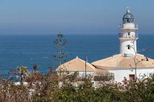 faro de Cullera con el mar en el fondo blog sol y paella beach houses valencia